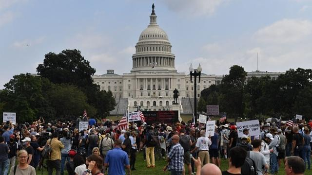 cbsn-fusion-large-police-presence-at-justice-for-j6-rally-at-us-capitol-thumbnail-795540-640x360.jpg