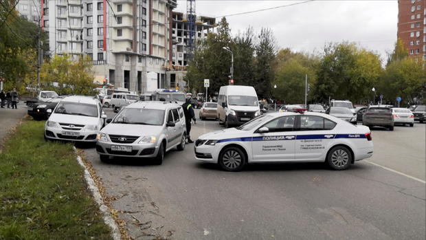 Police block the road near the scene of a shooting at university in Perm