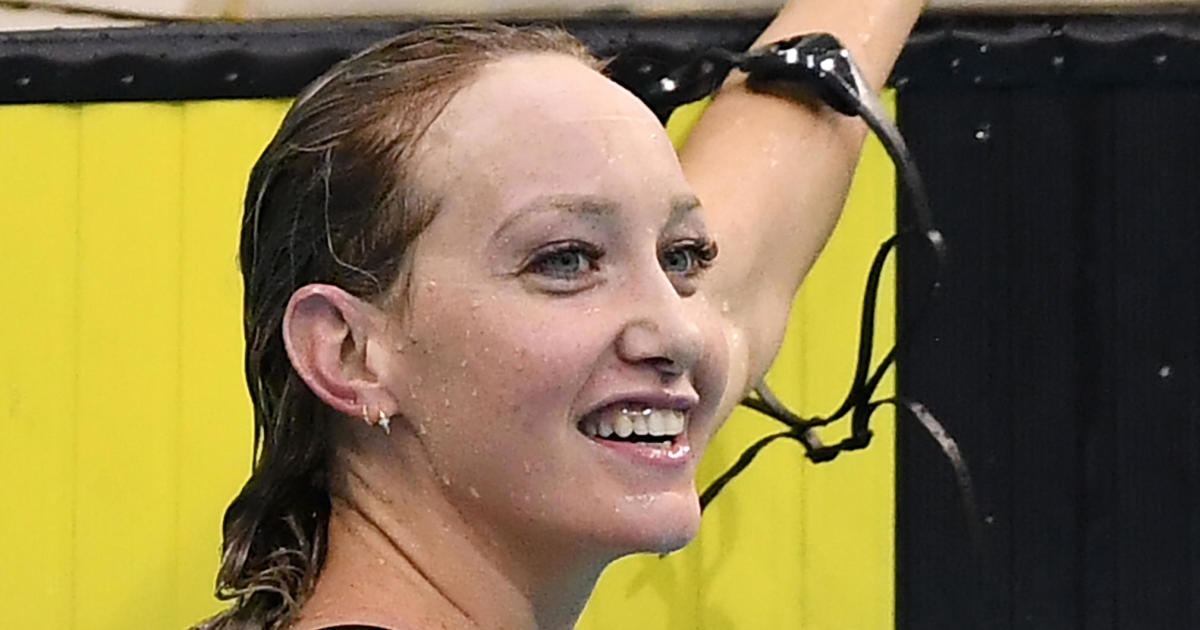 Swimmer who won gold at Tokyo Olympics says she's hospitalized with COVID-19