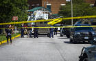 Police respond to the scene of a shooting at Heritage High School in Newport News, Virginia, on September 20, 2021.