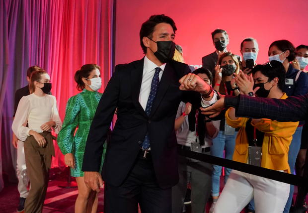 Canada's Liberal Prime Minister Justin Trudeau greets supporters during the Liberal election night party in Montreal