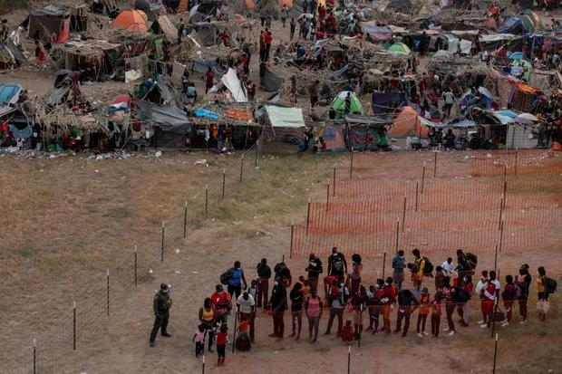 Migrants shelter near International Bridge in Del Rio, Texas