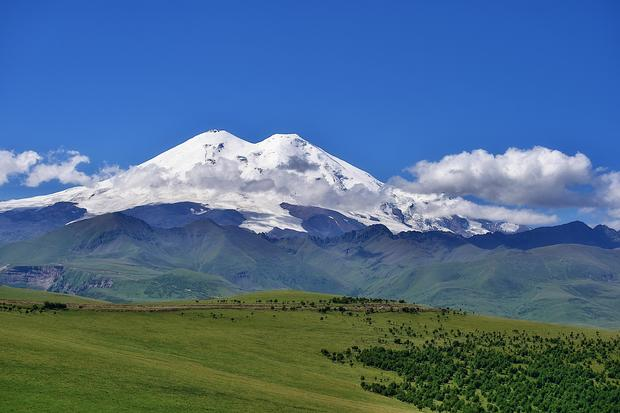 Elbrus Mountain. Scenic View Of Snowcapped Mountains Against Sky