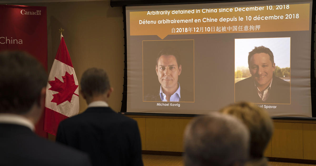 China releases Canadians it accused of spying after U.S. agrees to drop charges against top Huawei executive