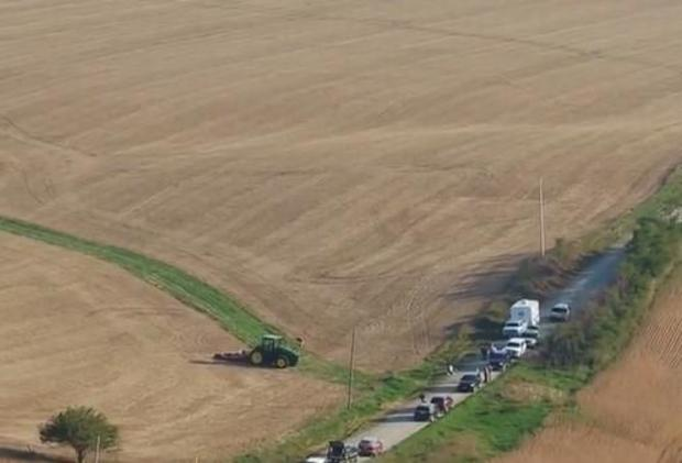 investigators-at-scene-in-iowa-field-on-093021-of-discovery-of-body-bellieved-to-be-missing-iowa-boy-xavior-harrelson.jpg