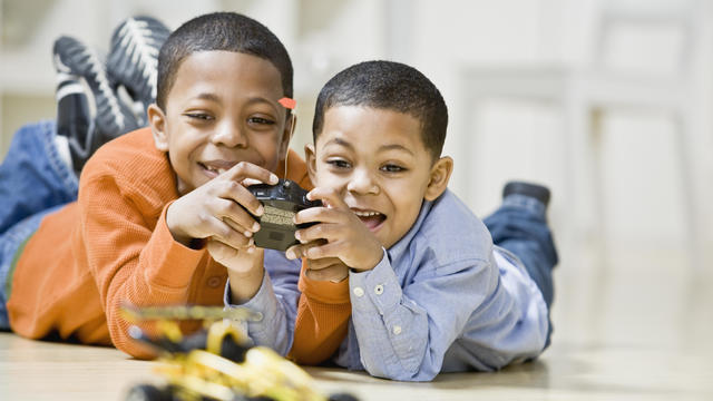 Brothers playing with remote control car