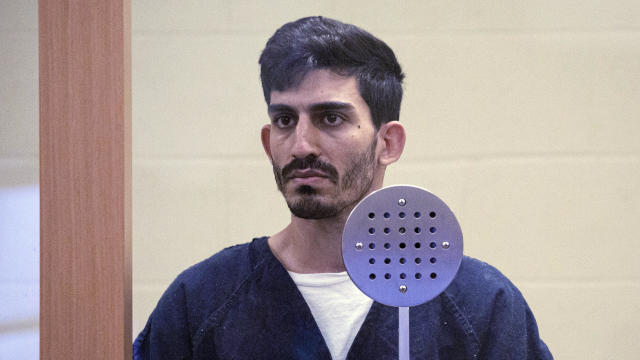 Ali Abulaban, 29, stands during his arraignment for a double homicide at the San Diego Central Courthouse on October 25, 2021, in San Diego, California.